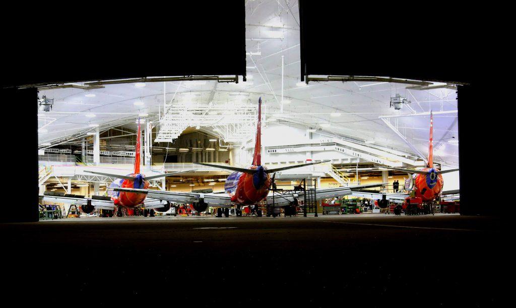 Moses Lake, WA night view through open hangar doors